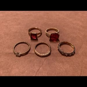 5 gold colored stacking rings w red & clear stones